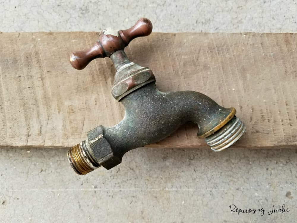 Repurposed Faucet into Hand Towel Holder