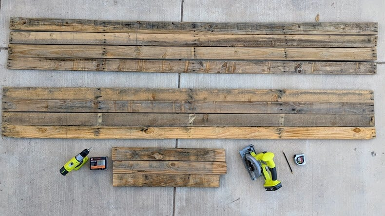 disassembled pallet wood for a raised garden bed
