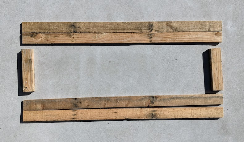 intial layout of pallet wood for raised garden bed