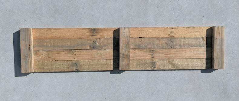 side panel of the raised garden bed from pallets