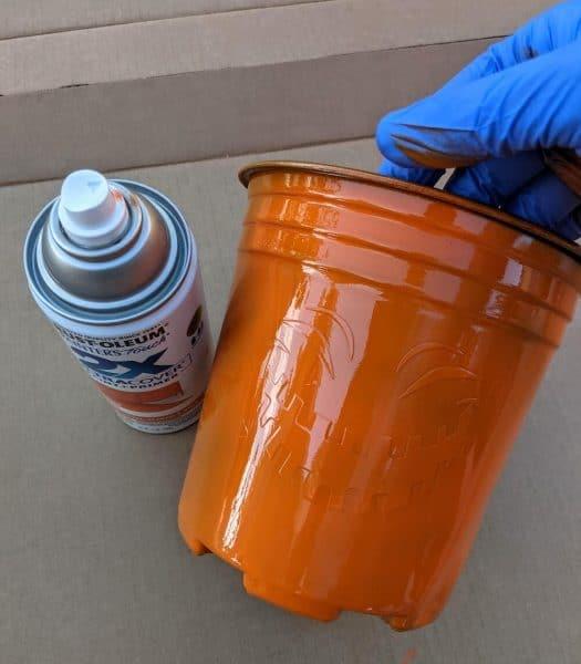 Pumpkin orange spaypaint over Cricut removeable vinyl